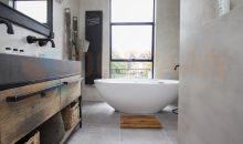 Microcement gietvloer naadloze badkamer betonlook